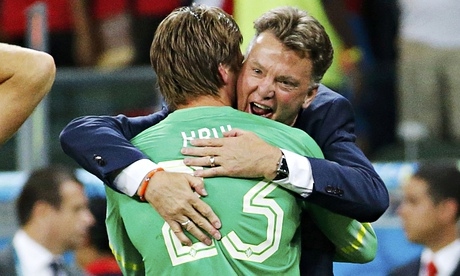 Tim Krul of the Netherlands is hugged by coach Louis van Gaal